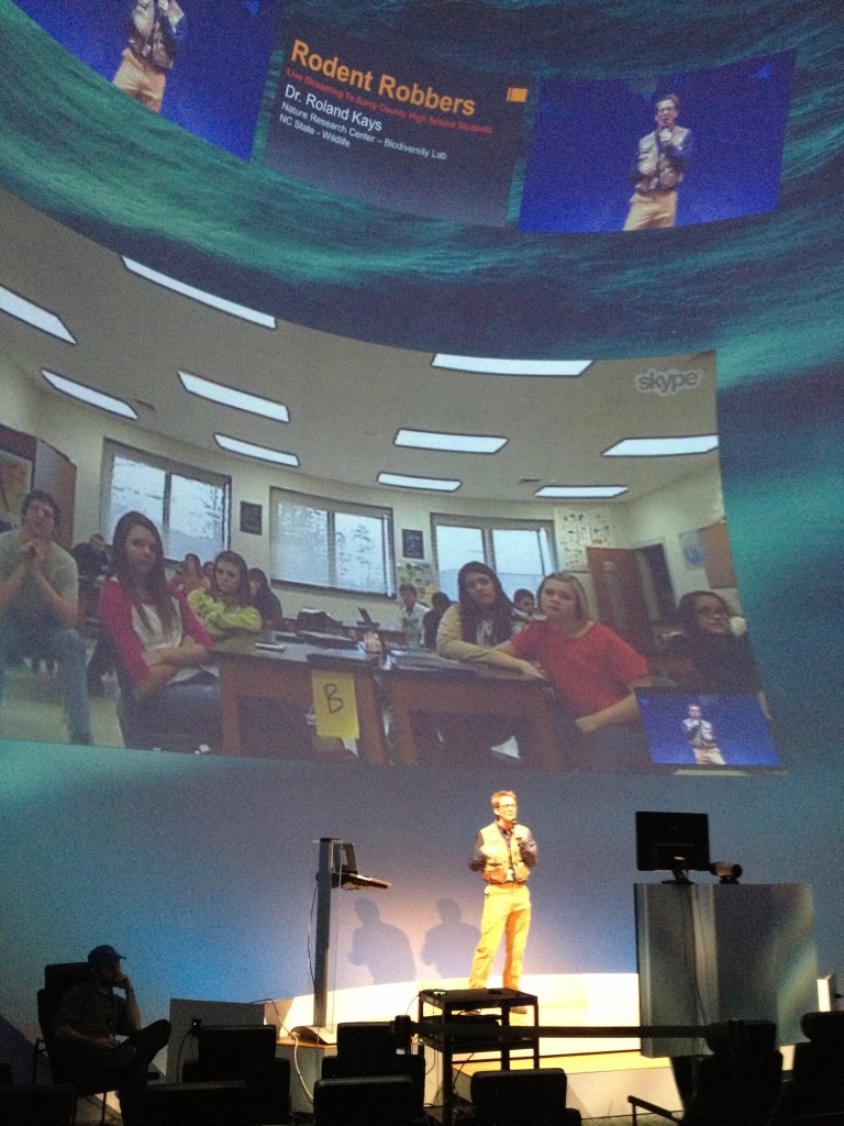 Dr. Kays using the Museum's Daily Planet Theater to talk with a school in western North Carolina.